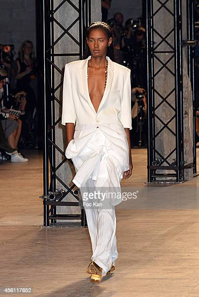 Model walks the runway during The Barbara Bui show as part of the Paris Fashion Week Womenswear Spring/Summer 2015 at the Palais de Tokyo on...