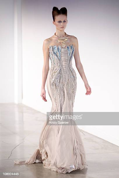 A model walks the runway during the Basil Soda show as part of the Paris Haute Couture Fashion Week Spring/Summer 2011 at Palais De Tokyo on January...