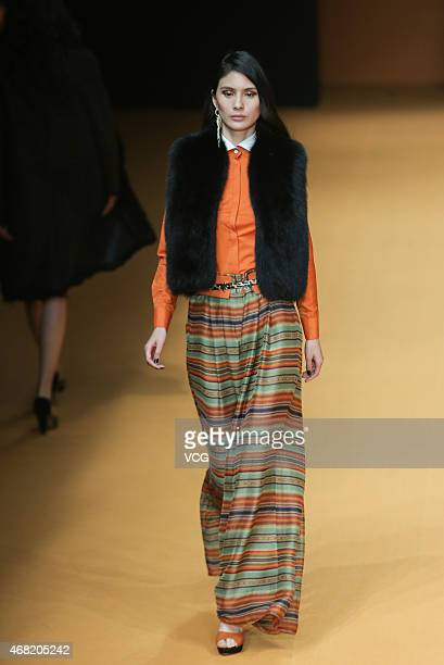 Model walks the runway during the Beauty Berry show as part of Mercedes-Benz China Fashion Week Autumn/Winter Collection on March 31, 2015 in...