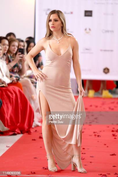 A model walks the runway during the BeautyNtheBox show at BNTB Cannes Fashion Week on May 14 2019 in Cannes France