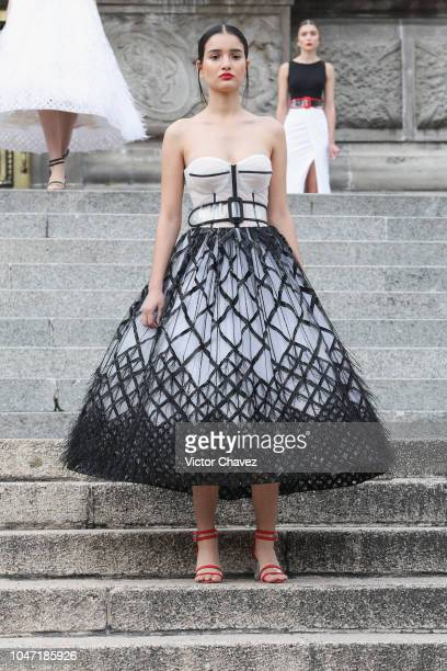 A model walks the runway during the Benito Santos at Mercedes Benz Fashion Week Mexico at Angel De La Independencia on October 7 2018 in Mexico City...