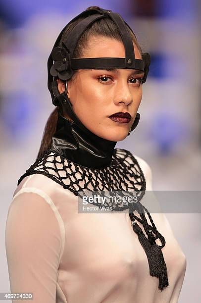 A model walks the runway during the Benito Santos Show as part of MercedesBenz Fashion Week Mexico Fall/Winter 2015 day 1 at Campo Marte on April 14...