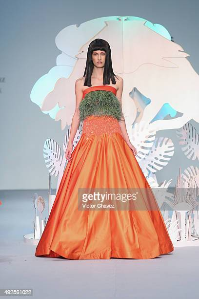 Model walks the runway during the Benito Santos show at Mercedes-Benz Fashion Week Mexico Spring/Summer 2016 at Campo Marte on October 13, 2015 in...