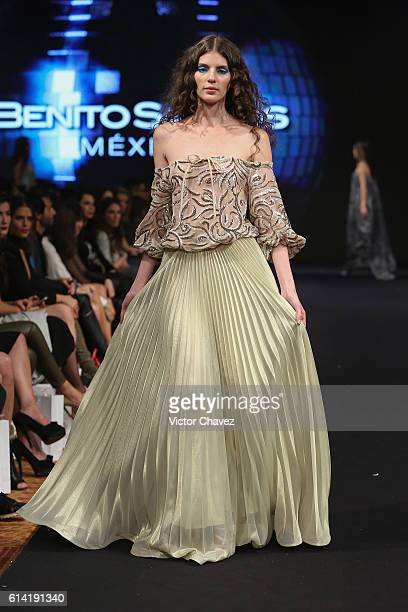 A model walks the runway during the Benito Santos show at MercedesBenz Fashion Week Mexico Spring/Summer 2017 at Maria Isabel Sheraton hotel on...