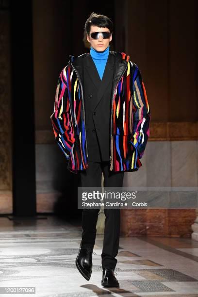 A model walks the runway during the Berluti Menswear Fall/Winter 20202021 show as part of Paris Fashion Week at Opera Garnier on January 17 2020 in...