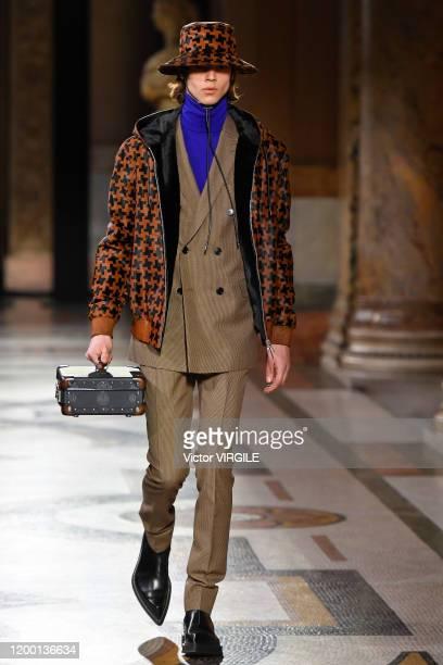Model walks the runway during the Berluti Menswear Fall/Winter 2020-2021 show as part of Paris Fashion Week at Opera Garnier on January 17, 2020 in...