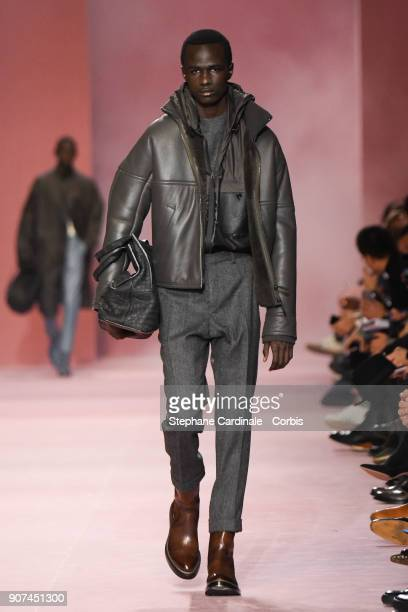 A model walks the runway during the Berluti Menswear Fall/Winter 20182019 show as part of Paris Fashion Week January 19 2018 in Paris France