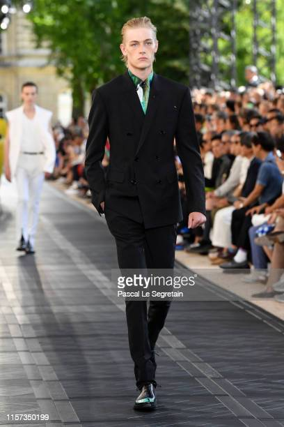A model walks the runway during the Berluti Menswear Spring Summer 2020 show as part of Paris Fashion Week on June 21 2019 in Paris France
