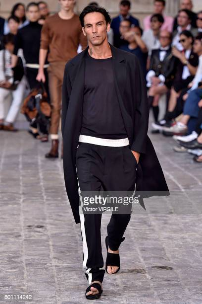 A model walks the runway during the Berluti Menswear Spring/Summer 2018 show as part of Paris Fashion Week on June 23 2017 in Paris France