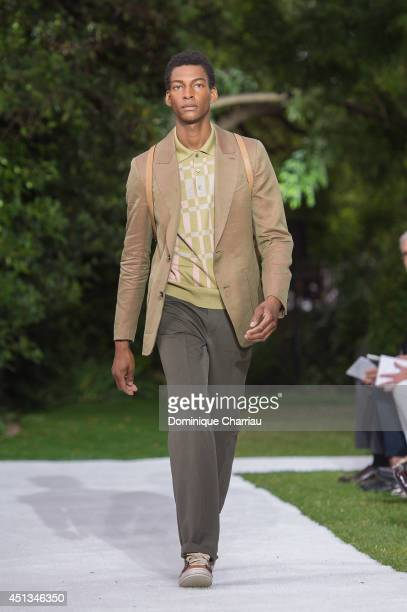 A model walks the runway during the Berluti show as part of the Paris Fashion Week Menswear Spring/Summer 2015 on June 27 2014 in Paris France
