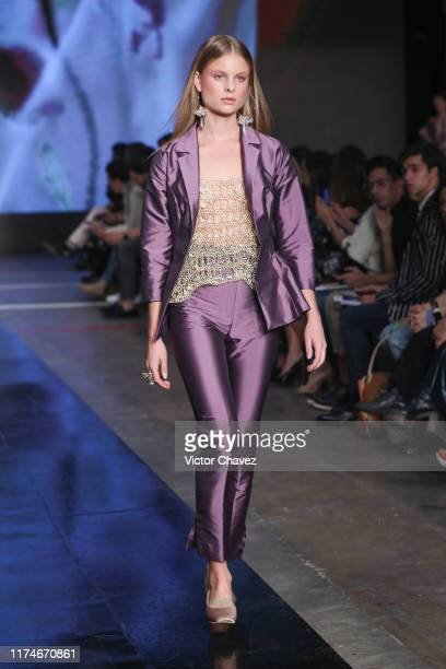 A model walks the runway during the Bernarda show as part of the MercedezBenz Fashion Week Mexico Spring/Summer 2020 Day 2 at Fronton Mexico on...