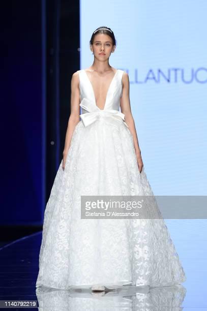 A model walks the runway during the Blumarine / Bellantuono Sposa show at Sposaitalia Collezioni on April 06 2019 in Milan Italy