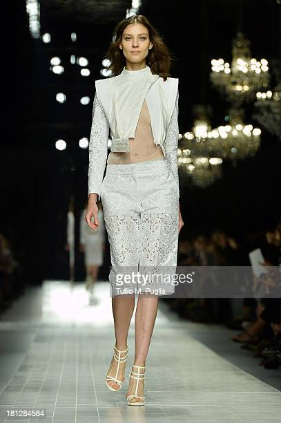 A model walks the runway during the Blumarine show as a part of Milan Fashion Week Womenswear Spring/Summer 2014 on September 20 2013 in Milan Italy