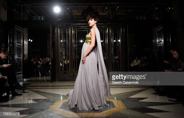 A model walks the runway during the BodyAmr Show at London Fashion Week Autumn/Winter 2011 at Freemasons Hall on February 22 2011 in London England
