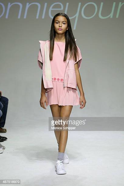 A model walks the runway during the Bonnie Young preview at petitePARADE / Kids Fashion Week at Bathhouse Studios on October 19 2014 in New York City