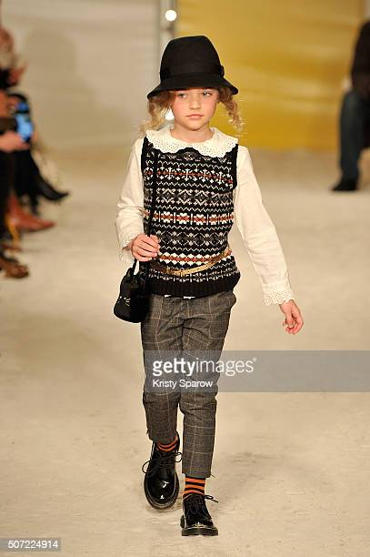 A model walks the runway during the Bonpoint Spring Summer 2016 show as part of Paris Fashion Week on January 27 2016 in Paris France