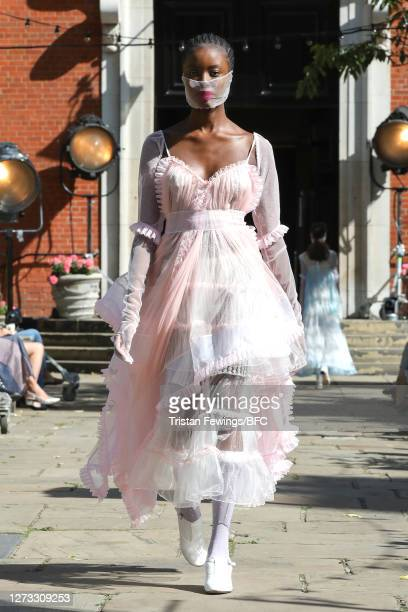 Model walks the runway during the Bora Aksu show during LFW September 2020 at St Paul's Church on September 18, 2020 in London, England.