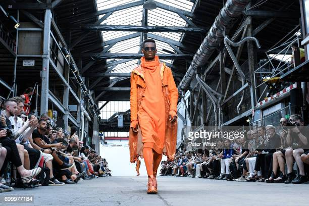 A model walks the runway during the Boris Bidjan Saberi Menswear Spring/Summer 2018 show as part of Paris Fashion Week on June 22 2017 in Paris France