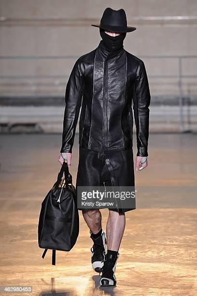 A model walks the runway during the Boris Bidjan Saberi Menswear Fall/Winter 20142015 show as part of Paris Fashion Week on January 16 2014 in Paris...