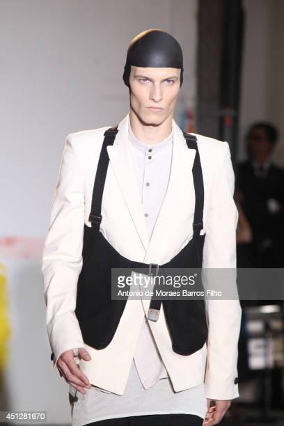 A model walks the runway during the Boris Bidjan Saberi show as part of the Paris Fashion Week Menswear Spring/Summer 2015 on June 26 2014 in Paris...