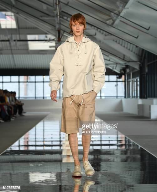 A model walks the runway during the BOSS Menswear SS18 show at Fulton Market Building on July 11 2017 in New York City / AFP PHOTO / ANGELA WEISS
