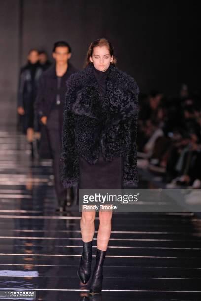 A model walks the runway during the BOSS Womenswear Menswear Fashion Show in February 2019 New York Fashion Week on February 13 2019 in New York City
