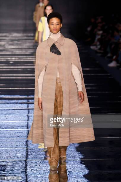 A model walks the runway during the BOSS Womenswear Menswear runway show on February 13 2019 in New York City