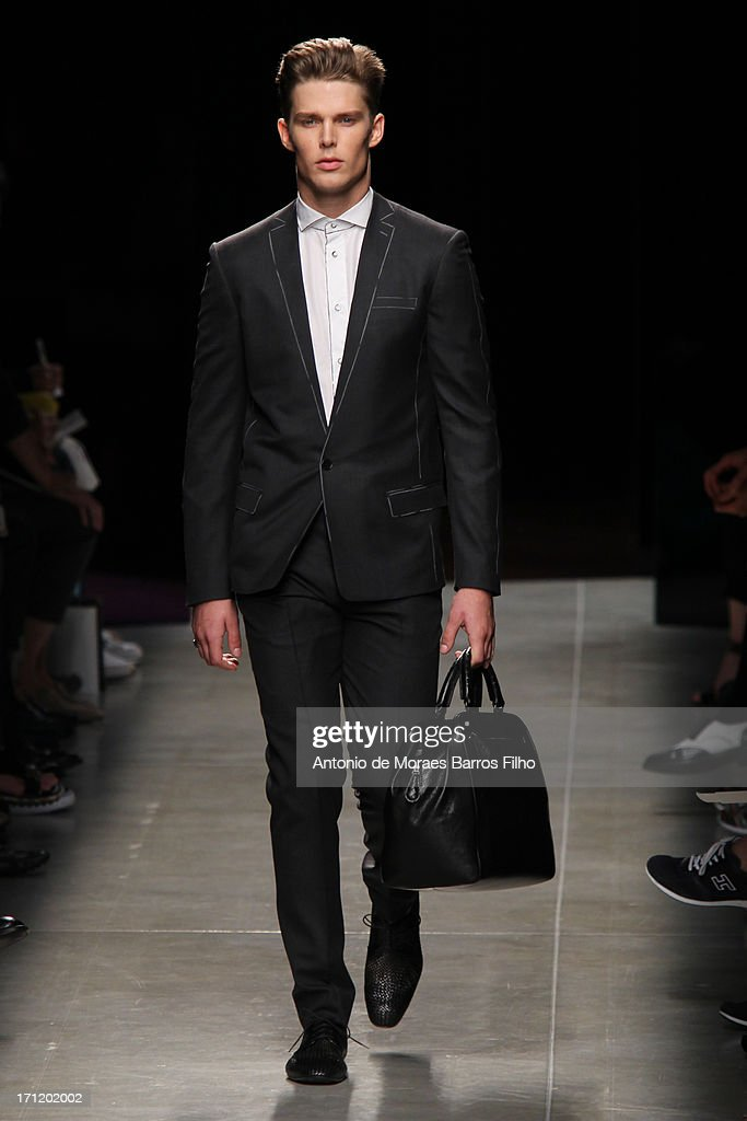A model walks the runway during the Bottega Veneta show as a part of MFW S/S 2014 on June 23, 2013 in Milan, Italy.