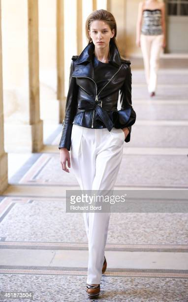 A model walks the runway during the Bouchra Jarrar show as part of Paris Fashion Week Haute Couture Fall/Winter 20142015 at Lycee Henri IV on July 8...
