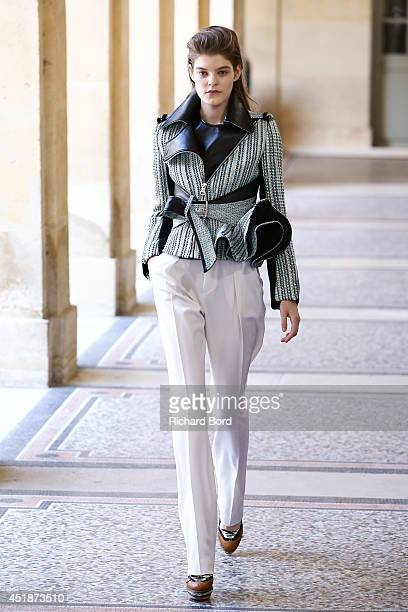 Model walks the runway during the Bouchra Jarrar show as part of Paris Fashion Week - Haute Couture Fall/Winter 2014-2015 at Lycee Henri IV on July...