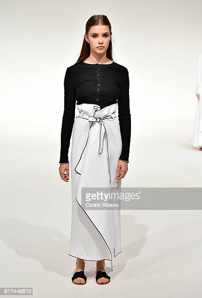 A model walks the runway during the Bouguessa presentation at Fashion Forward Spring/Summer 2017 held at the Dubai Design District on October 23 2016...