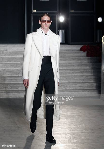 A model walks the runway during the Brioni Haute Couture Fall/Winter 20162017 show as part of Paris Fashion Week on July 4 2016 in Paris France