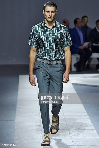 A model walks the runway during the Brioni Ready to Wear fashion show as part of Milan Men's Fashion Week Spring/Summer 2016 on June 22 2015 in Milan...
