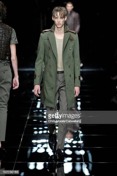 A model walks the runway during the Burberry Prorsum fashion show at Milan Menswear Fashion Week for Spring Summer 2011 on June 19 2010 in Milan Italy
