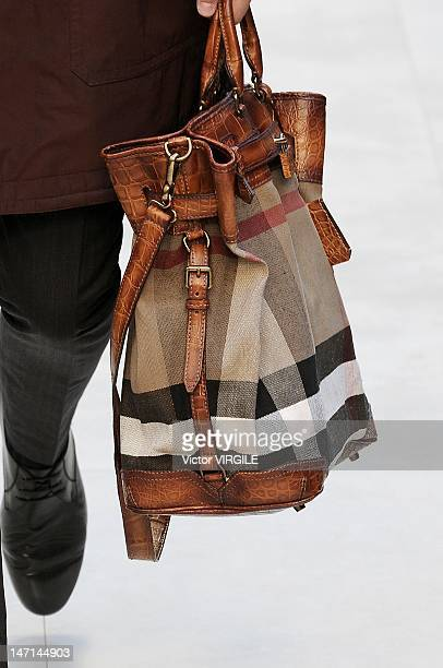 A model walks the runway during the Burberry Prorsum show as part of Milan Fashion Week Menswear Spring/Summer 2013 on June 23 2012 in Milan Italy