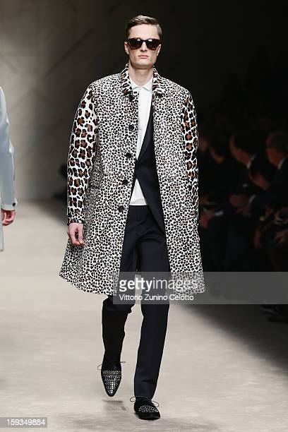 A model walks the runway during the Burberry Prorsum show as part of Milan Fashion Week Menswear Autumn/Winter 2013 on January 12 2013 in Milan Italy