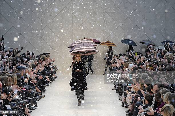 A model walks the runway during the Burberry Prorsum show at London Fashion Week Autumn/Winter 2012 at Kensington Gardens on February 20 2012 in...