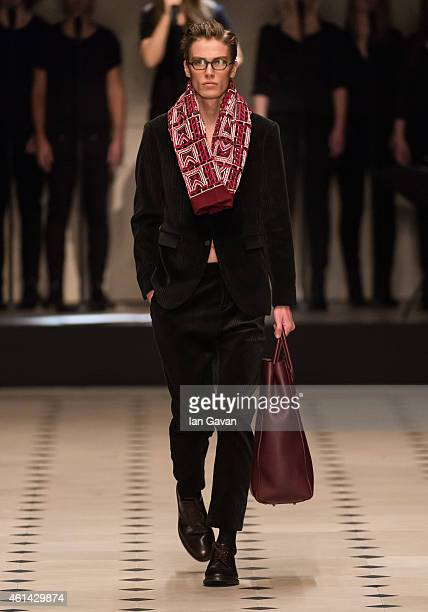 A model walks the runway during the Burberry Prorsum show at the London Collections Men AW15 at Albert Memorial on January 12 2015 in London England