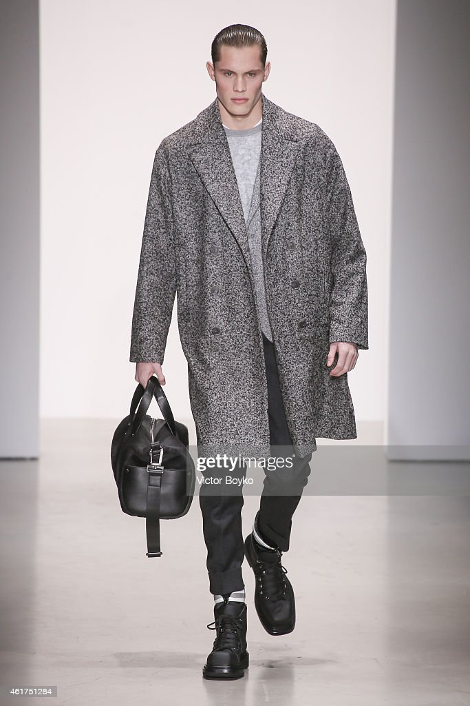 A model walks the runway during the Calvin Klein show as a part of Milan Menswear Fashion Week Fall Winter 2015/2016 on January 18, 2015 in Milan, Italy.