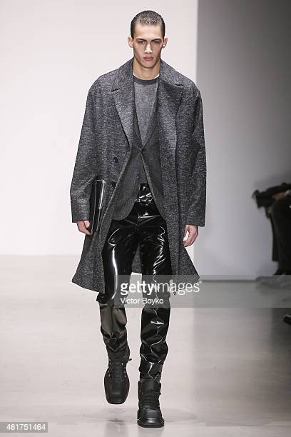 A model walks the runway during the Calvin Klein show as a part of Milan Menswear Fashion Week Fall Winter 2015/2016 on January 18 2015 in Milan Italy
