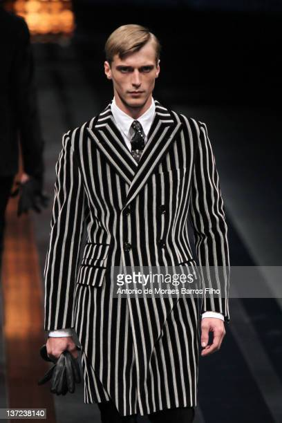 A model walks the runway during the Canali fashion show as part of Milan Fashion Week Menswear Autumn/Winter 2012 at on January 16 2012 in Milan Italy
