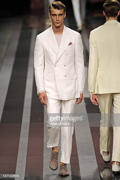 A model walks the runway during the Canali ready to Wear Spring/Summer 2013 show as part of the Milan Men Fashion Week on June 25 2012 in Milan Italy