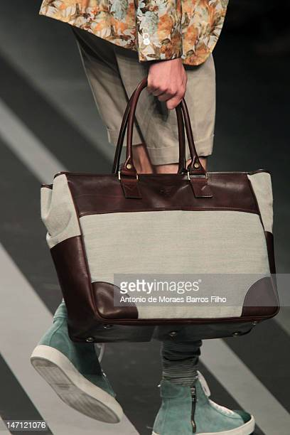 A model walks the runway during the Canali show as a part of Milan Fashion Week Menswear Spring/Summer 2013 on June 25 2012 in Milan Italy