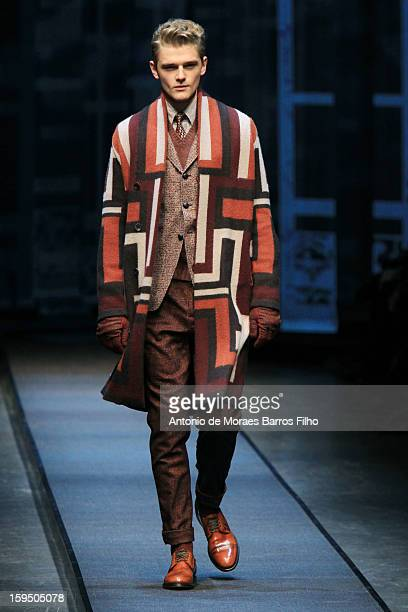 A model walks the runway during the Canali show as a part of Milan Fashion Week Menswear Autumn/Winter 2013 on January 14 2013 in Milan Italy