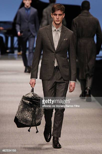 Model walks the runway during the Canali show as a part of Milan Fashion Week Menswear Autumn/Winter 2014 on January 13, 2014 in Milan, Italy.