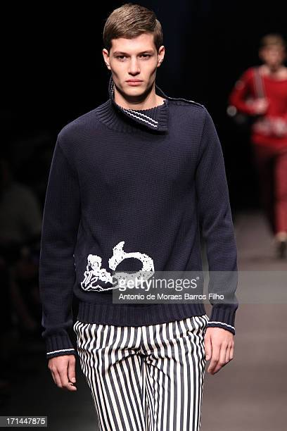 A model walks the runway during the Canali show as part of MFW S/S 2014 on June 24 2013 in Milan Italy