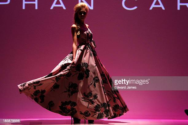 A model walks the runway during the Caras Stephan Caras fashion show at David Pecaut Square on October 25 2013 in Toronto Canada