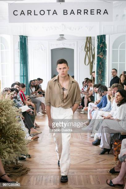 A model walks the runway during the Carlota Barrera show at Mercedes Benz Fashion Week Madrid Spring/ Summer 2019 on July 12 2018 in Madrid Spain