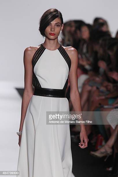 A model walks the runway during the Carmen Marc Valvo show at MercedesBenz Fashion Week Spring 2015 at The Theatre at Lincoln Center on September 5...