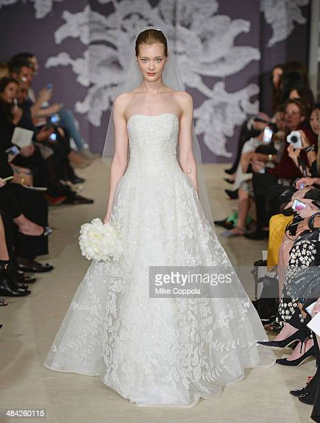 Model walks the runway during the Carolina Herrera Spring 2015 Bridal collection show at on April 11, 2014 in New York City.